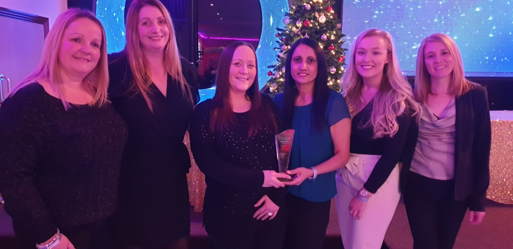 Sandwell Council Workplace Nursery staff collecting Outstanding Ofsted award