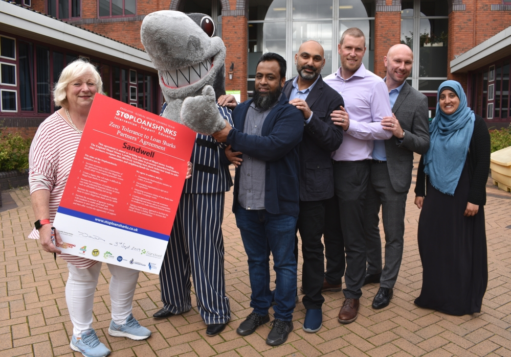 Councillor Yvonne Davies and partners promote the Stop Loan Sharks campaign