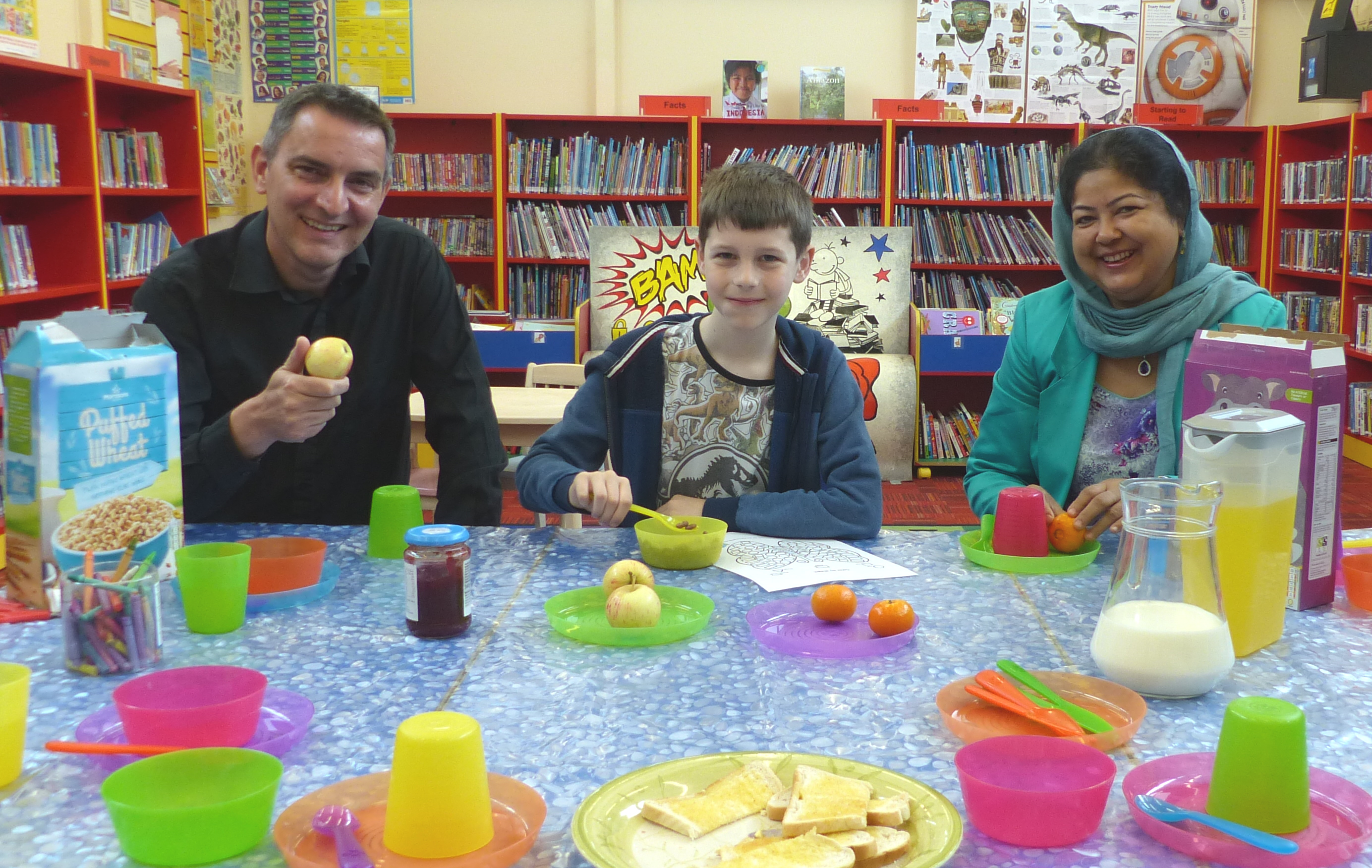 Cllr Hackett, Oliver and Cllr Khatun with breakfast at Stone Cross