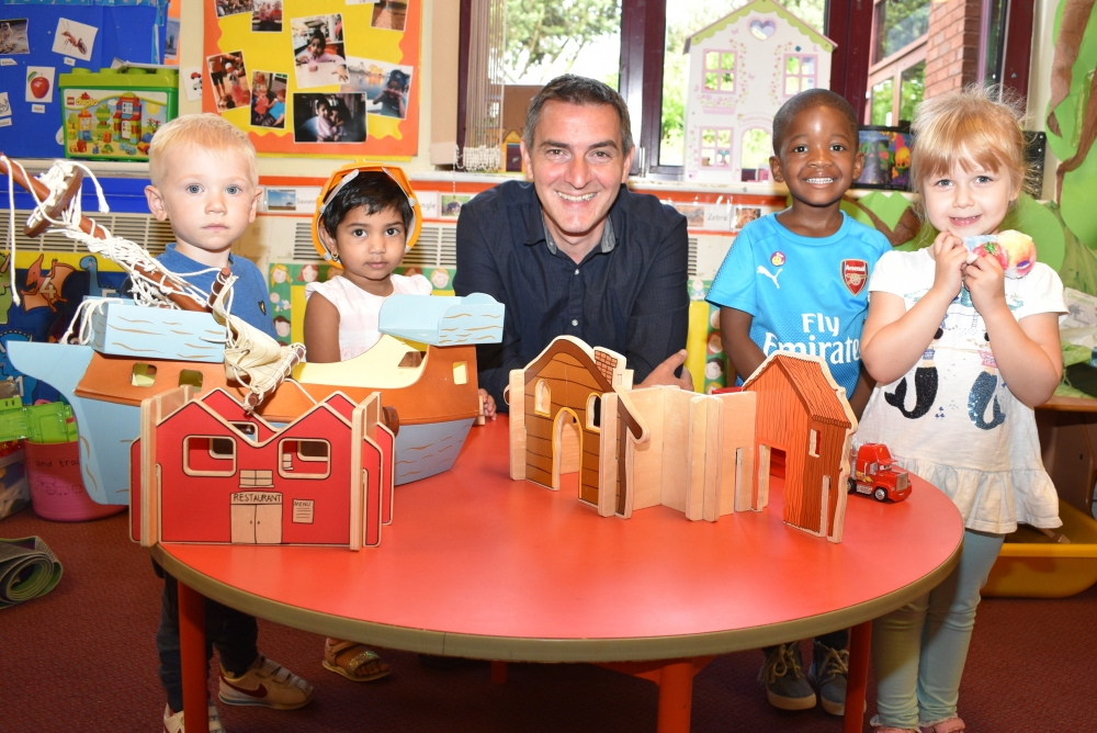 Councillor Hackett with children at nursery